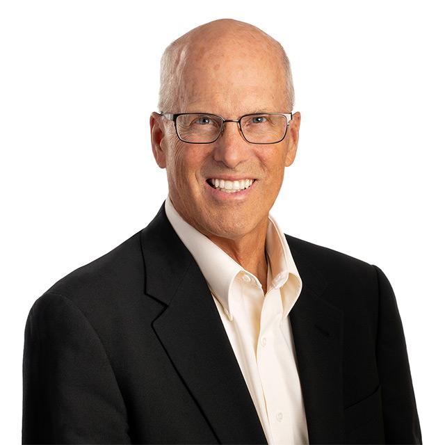 Professional headshot of man wearing glasses