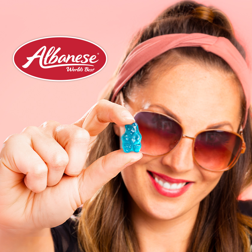 Albanese ad with girl holding gummy bear